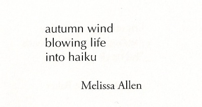 "A haiku reading ""autumn wind/blowing life/into haiku"""