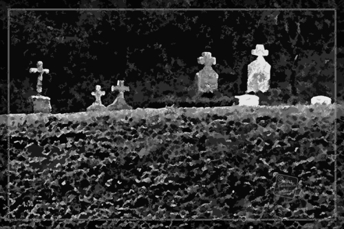 Gravestones behind a hedge